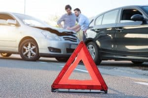 Car Accident Injuries from Road Debris—Who Can You Sue for Damages?